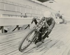 """Racing on wood-lined tracks on motorcycles with no brakes and no clutch pushing 100 Miles Per Hour with tires not much bigger than a ten-speed bicycle ...... now this was entertainment!,..it was the """"biggest thrill of all"""" back in 1908-1915. After the war the tracks got bigger and are called Board Tracks, - not as exciting as the smaller Motordromes (1/4 or 1/3 laps to a mile) tracks."""