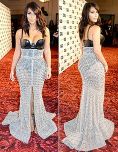 Kim Kardashian shows off her figure in a see-through skirt and leather bustier bodysuit by Ralph & Russo at the GQ Men Of The Year awards in London