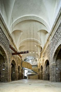 Reimagined nave of the former Church of Sant Francesc located in the Spanish town of Santpedor. The 18th century church had nearly crumbled to the ground when it was re-purposed into into an auditorium and a multi-functional cultural facility. [1440  2160]
