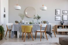 Photo about Real photo of an elegant dining room interior with a laid table, chairs, mirror on a wall and lamps. Image of chairs, elegant, celebration - 128602821 Table And Chairs, Dining Chairs, Dining Table, Elegant Dining Room, Room Interior, Accent Chairs, Ikea, Wall, Master Bedroom