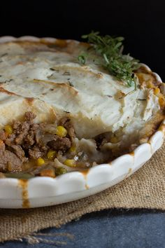 Ground lamb cooked with vegetables in a rich brown gravy and topped with fluffy mashed potato make shepherd's pie an easy one dish dinner choice.
