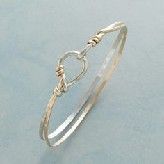 """ENTWINED BANGLE--Whisper light and so easy to wear: this multi-strand bangle bracelet has two slender strands, one sterling silver, the other 14kt gold filled, which intertwine and fasten with a sterling hook and loop. USA. Exclusive. 2-1/2"""" dia."""