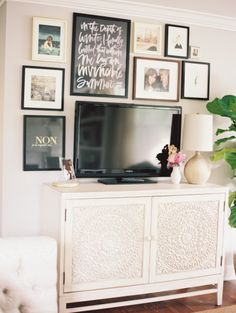 Gallery & Inspiration | Picture. Dresser as a tv stand with picture frames arranged around.