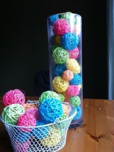 dye wicker/rattan balls with easter egg dyes; dry; use as filler in hurricanes, baskets, or glue together for a wreath