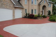 Gray Brushed Concrete Driveway with Decorative Stamped and Colored Concrete Borders.