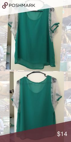 Green sheer blouse w/lace sleeves Loose and flowing shirt that looks great with colored jeggings and boots. No snags or piling. Worn but in great shape. Tops Blouses