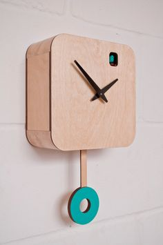 Turquoise Plywood Quartz Cuckoo Clock and pendulum
