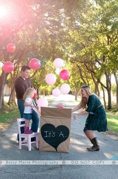 """Did a version of this. Wrapped a box w/an """"Its A Girl!"""" balloon inside as we'll as pink nail polish, lipstick, pink purse calendar, etc for the in-laws and my family to open. They kept all the pretty pink gifts that were inside as we'll as the balloon."""