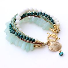 Beach Womens Bracelet. Youll be ready for the beach with this handmade bracelet featuring beach glass, freshwater pearls, mountain jade, seed beads, and gold plated beads and findings, all adorned with a cute shell charm. Length: Approximately 6.5 inches. Can be adjusted upon request.