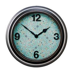 Update your wall clock with patterned paper (or wallpaper) scrapbooking numbers and craft glue.