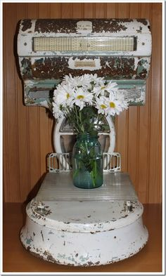 Vintage scale adorned with mason jar filled with Daisy's