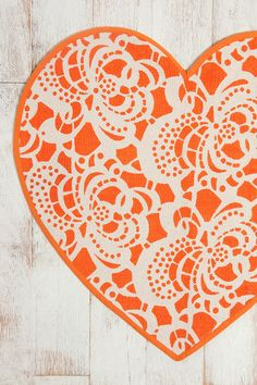 A bold touch for a living room or family room: an orange heart rug!  #designinspiration