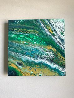 This unique and original fluid acrylic pour painting on canvas, was created with a range of greens, blues, and yellows with a splash of white. I used acrylics and mixed media on a high quality stretched archival 1.5 inch thick museum quality canvas. It was sealed with high gloss