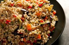 This grilled ggplant and bell pepper recipe has the flavors of baba ghanoush, folded into a healthy summer side dish.