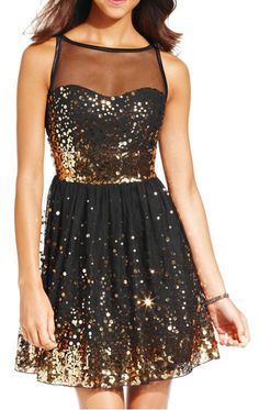 Black and Gold Show Stopper Dress. Classically cute! This dress would certainly make a statement. #sponsored