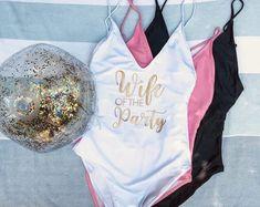 Wife of the Party Swimsuit – Bride Swimsuit - Bachelorette Bathing Suit – Bride Swimwear - Team Bride Swimsuit - Onepiece Swimsuit #bridalswimswear #luxuryswimswear #swim #onepiece Bachelorette Outfits, Bachelorette Weekend, Bachelorette Parties, Rose Gold Fabric, Pink Fabric, Bathing Suits One Piece, One Piece Swimsuit, Suits Show, Shower Outfits