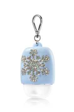 Blue Snowflake - PocketBac Holder - Bath & Body Works - Let it snow! This gorgeous glittering snowflake adds a wintry accent to your favorite PocketBac. The convenient clip attaches to your backpack, purse and more so you can always keep your sanitizer close at hand.