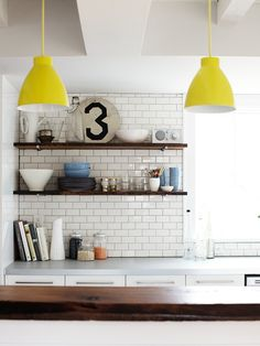 beautiful subway tile kitchen. i will never, ever get into exposed shelving in the kitchen though. you know why people started using cabinets in the first place? to keep dust and bugs off of your shit. keep it that way.