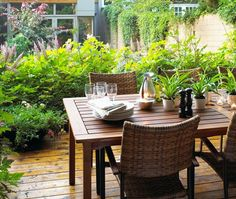 Outdoor Dining Room    Beautiful landscaping and neutral furniture turn this backyard patio into a cosy retreat.