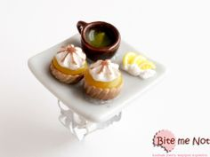 Lemon tarts and tea -White metal filigree adjustable ring base!  -Rectangular ceramic plate on which are served two delicious lemon tarts and a brown ceramic cup of tea with lemon slice! The plate is decorated with vanilla creme and lemon slices!