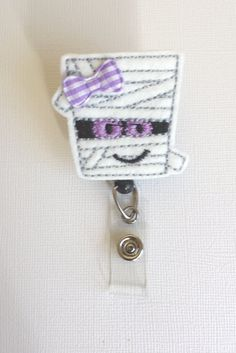 Purple & White Mummy Felt Badge Reel  by SimplyReelDesigns on Etsy, $6.25