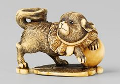 An ivory netsuke of a dog. 19th century
