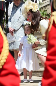 Kate Middleton Photos - Princess Charlotte and Catherine, Duchess of Cambridge leave St George's Chapel at Windsor Castle after the wedding of Prince Harry, Duke of Sussex and Meghan Markle on May 19, 2018 in Windsor, England. - Prince Harry Marries Ms. Meghan Markle - Windsor Castle