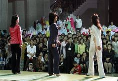 In this September 19, 2012 photo, North Korean women perform during a fashion show at the 10th national Korean dress exhibition at Central Youth Hall in Pyongyang, North Korea.