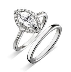 Marquise style engagement ring with matching plain wedding ring