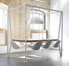 The most entertaining dining table ever. Swing chairs!