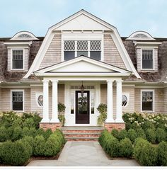not normally a dutch colonial fan, but like this (minus the upper sashes of center windows)
