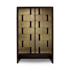 """ARMOIRE W52.75""""X D21"""" X H81.75"""" HIGH GLOSS EBONIZED WALNUT & BURNISHED BRASS    STANDARD FINISHES:  DOORS Un-Lacquered or Burnished Brass, Burnished Silver  STAIN Un-Lacquered Brass or Burnished Brass, Burnished Silver Doors Available in All Stain with Score Lines at Doors and Stained Rosettes  Available as Sideboard  Custom Capabilities   VIEW TEARSHEET  VIEW FINISHES"""