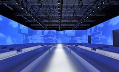 Salvatore Ferragamo The screens that framed the show space at Milan's Palazzo Mezzanotte were emblazoned with moving images of a deep blue sky, superimposed with geometric elements that echoed the forms of the modular white seating.