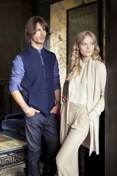 She wears the Edge to Edge Cardigan in Putty, he wears the Mandarin Gilet in Eclipse Navy