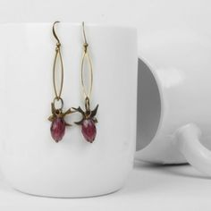 Our gorgeous New antiqued brass and Czech glass fire glazed bead earrings on an elegant hook are €18.95 from www.artysmartyshop.com  These dainty hanging leaf shaped earrings made from antiqued brass and a pretty Czech glass bead, are inspired by the Irish countryside. We have created these #contemporary pieces at our #Dublin studio, where we handcraft all of our beautiful #jewellery. #artysmartyshop #ladies #fashion #accesories #handmadejewelery #jewelery #fashionaccessories Dangly Earrings, Drop Earrings, Leaf Shapes, Czech Glass Beads, Dublin, Antique Brass, Free Gifts, Earrings Handmade, Countryside