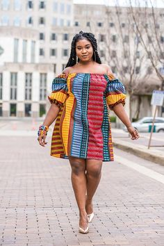 Description This African Off Shoulder Dress is everything youve been looking for! It is a unique Ankara dress handmade with true African print fabric patterns that make you stand out! African Print Dresses, African Fashion Dresses, African Attire, African Wear, African Dress, African Prints, Ankara Short Gown Styles, Trendy Ankara Styles, Ankara Gowns