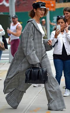 Cute and Comfy from Bella Hadid's Best Looks  Stepping out in New York City, the Hadid sister looked flowy and fabulous in loose plaid pantsand matching oversized coat. She rounded out the look with a Givenchy purse and leather cap.