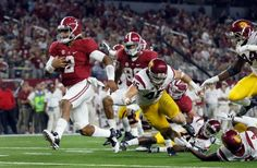 Alabama quarterback Jalen Hurts slips into the end zone on a 7-yard touchdown run during the second half of an NCAA college football game against Southern California on Saturday, Sept. 3, 2016, in Arlington, Texas. (AP Photo/Tony Gutierrez)