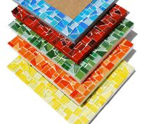 4 x 6 Monochromatic mosaic picture frame. The color is up to you! Choose from Red, Orange, Yellow, Green, Blue, Purple, Pink, Black, Gray, or White!  These pretty mosaic picture frames make fantastic gifts! Each photo frame is handcrafted so no two will be exactly alike. MEASUREMENTS: Overall: 9 1/4 inches x 7 1/4 inches Mosaic Border: 1 3/4 inches Picture Opening: 4 x 6 DETAILS: * Made for either a horizontal or vertical photograph * Has an easel on the back for tabletop display * Solid…