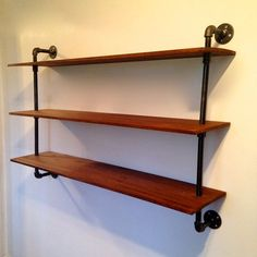 Wall-Mounted Bookshelf // Reclaimed Wood & Pipe Bookshelf- We made our coffee table with plumbing parts & it was surprisingly easy. This looks awesome!