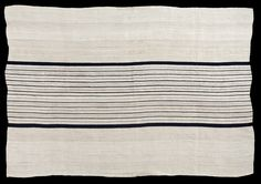 Very rare mid C20th cloth woven from a white bast fibre called ebase in a remote village called Somorika high in rugged hills near the Niger-Benue confluence in central Nigeria. The fibre was obtained by pounding narrow branches of a particular tree in a mortar until they softened and broke down and could be spun to make a soft heavy thread.