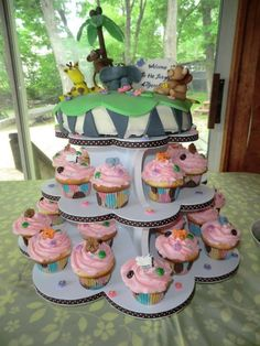 Baby Shower cupcake tower with baby jungle animals on top cake