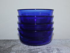 Four vintage blue sapphire cobalt glass bowls made by Arcoroc France. Perfect for fruit or dessert.  Dimensions: 4.75 across, 2 1/8 tall  If youd