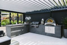 Ultra contemporary outdoor kitchen area with alfa woodfired oven for pizza and slow-cooking as well as barbecue and counter space. Part of a large garden and landscape design. Outdoor Grill Area, Modern Outdoor Kitchen, Outdoor Cooking Area, Outdoor Kitchens, Bbq Area Garden, Barbacoa, Back Garden Design, Outdoor Fireplace Designs, Outdoor Rooms