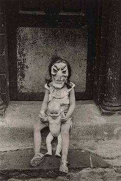 "Photographed in New York by Diane Arbus: Masked Child with a Doll, 1961 Gelatin silver print (printed ""later"" by Neil Selkirk)... terrifying"