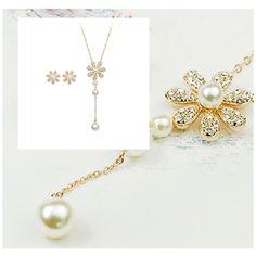 Set bijuterii placate cu aur 18KRGP, perle si cristale Austria Stellux Collection, format din lantisor cu pandantiv si cercei asortati, un set deosebit de fin si elegant cu o stralucire de exceptie. www.bodyandbijoux.ro