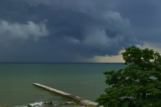 Lake Erie as the storms roll in across the green waters