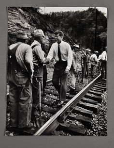 John F. Kennedy meeting coal miners while campaigning in West Virginia in 1960.