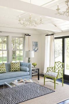Love the bright and charming feel to this space. Check out our Jess loveseat.