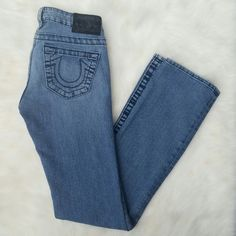 """True Religion Johnny Straight Leg Jeans Subtle whiskering in front and slight distressed areas. Condition: Great! Lightly worn with slight wear & fade. 82% cotton. 17% elasterell-p. 1% spandex. Inseam: 31"""". Made in USA. Section: Johnny/ RN# 112790/ Cut# 604225/ Style: W09502EM NO TRADES!! True Religion Jeans Straight Leg"""
